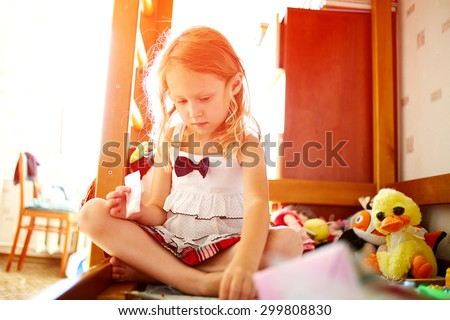 cute little girl playing with toys at home - stock photo