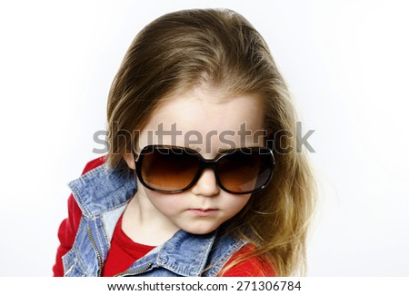 Cute little girl posing in mother's sunglasses, childhood concept, isolated on white - stock photo