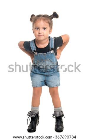 Cute little girl posing in studio over white background - stock photo