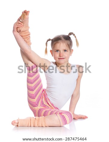 Cute little girl practice yoga. Isolated on the white background - stock photo