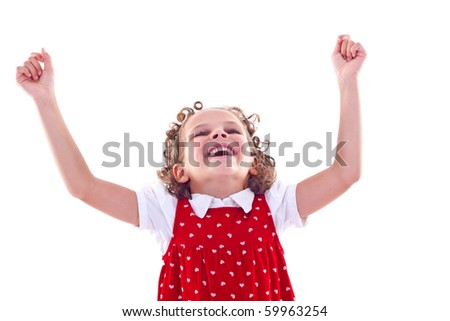 Cute little  girl raises her hands in a victory sign isolated