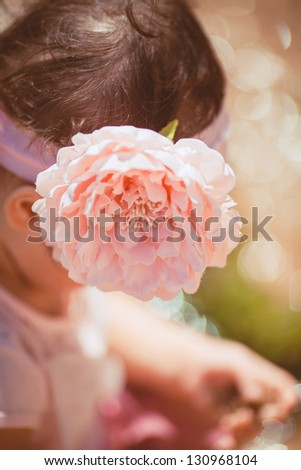 Cute little girl resting outdoor in summer time - stock photo