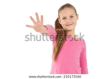 Cute little girl showing her hand on white background - stock photo