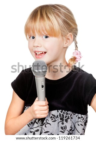 Cute little girl singing holding microphone on white background - stock photo