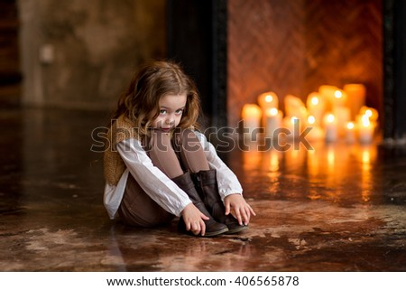 cute little girl sitting by the fire nation