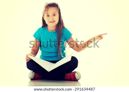 Cute little girl sitting cross legged and learning