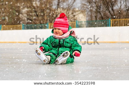 cute little girl sitting on ice with skates, kids sport - stock photo