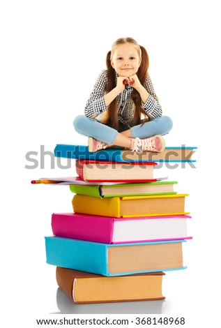 Cute little girl sitting on stack of books isolated on white