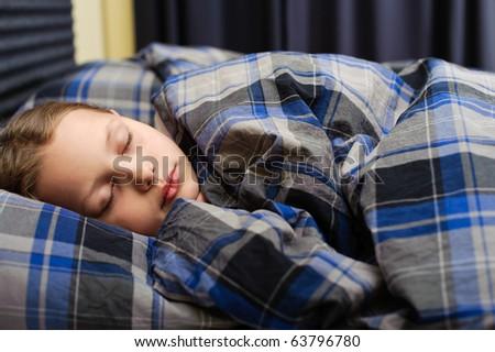 Cute little girl. Sleeping in bed. - stock photo