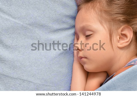 cute little girl sleeping in her bed at home - stock photo