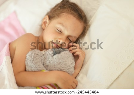 Cute little girl sleeping with a toy in her bed. Adorable Little Girl Sleeping Bed Her Stock Photo 129461543