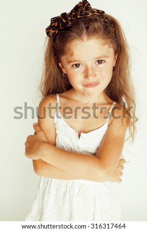 cute little girl smiling isolated on white background close up - stock photo