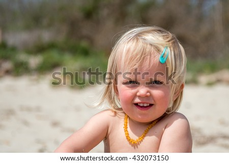 Cute little girl smiling on the beach.Summer vacation concept