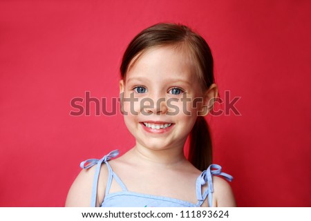 Cute little girl smiling over bright pink background - stock photo