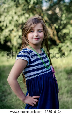 Cute  little girl summer portrait.