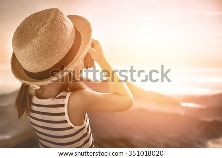 cute little girl takes photos of nature - stock photo