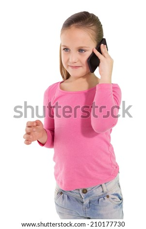 Cute little girl talking on smartphone on white background