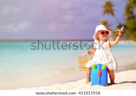 cute little girl travel on summer beach - stock photo