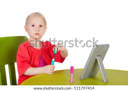 cute little girl using cosmetics