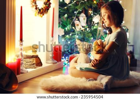 Cute little girl waiting Christmas night  - stock photo