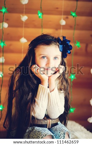 Cute little girl waiting for magical Christmas night