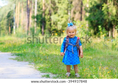 cute little girl walking in summer forest - stock photo