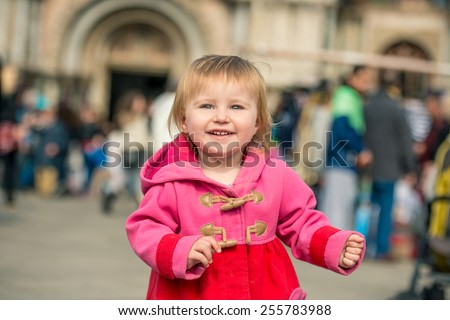 cute little girl walking on the Piazza San Marco in Venice, Italy - stock photo