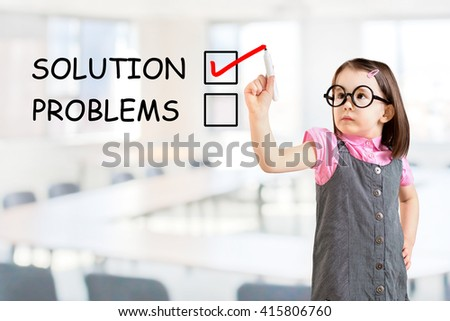 Cute little girl wearing business dress and check mark on solution concept. Office background.