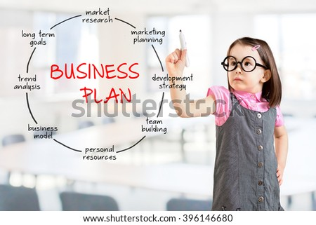 Cute little girl wearing business dress and drawing business plan concept. Office background. - stock photo