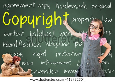 Cute little girl wearing business dress and showing copyright concept on green chalk board. - stock photo