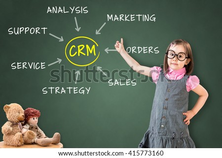 Cute little girl wearing business dress and showing customer relationship management process concept on green chalk board.  - stock photo