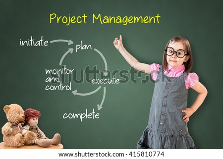 Cute little girl wearing business dress and showing project management workflow on green chalk board. - stock photo