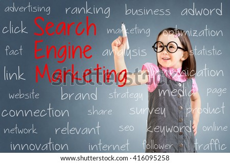 Cute little girl wearing business dress and writing search engine marketing concept. Blue background. - stock photo