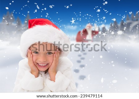 Cute little girl wearing santa hat against bright blue sky over clouds - stock photo