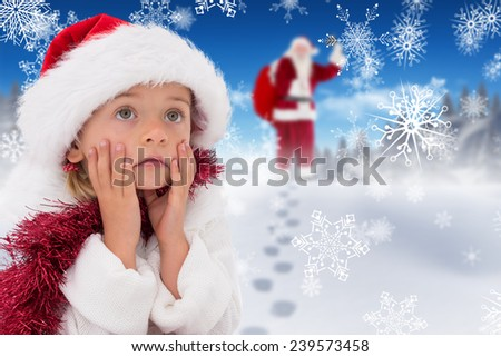 Cute little girl wearing santa hat and tinsel against bright blue sky over clouds - stock photo
