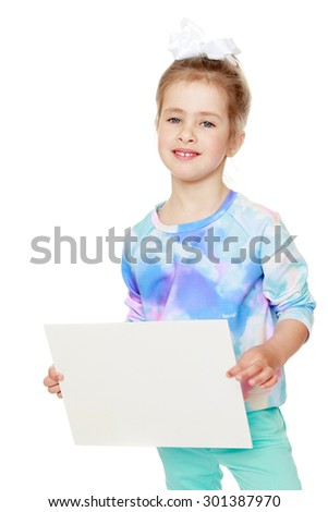 cute little girl with a bow on her head  He is holding to a rectangular piece of white paper or cardboard. On this sheet you can write something-Isolated on white background - stock photo