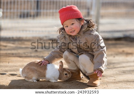 Cute little girl with a bunny rabbit