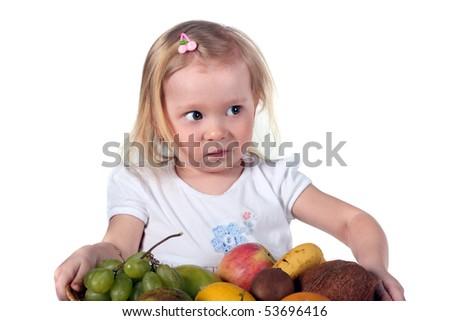 cute little girl with a dish full of fruits