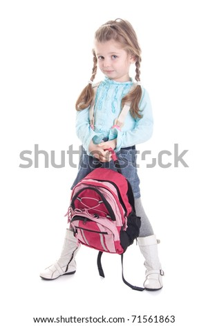Cute little girl with backpack, isolated on white background - stock photo