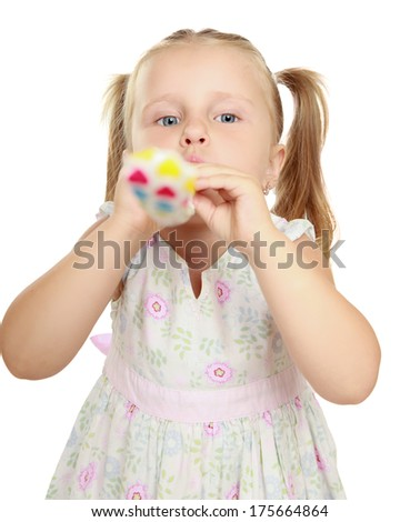 Cute little girl with blowouts toy - stock photo