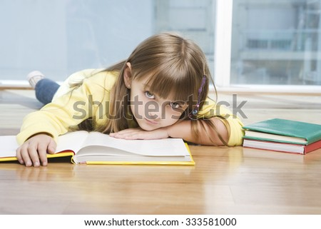 Cute little girl with books - stock photo