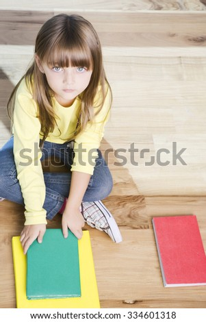 Cute little girl with books, back to school - stock photo