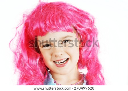 Cute little girl with bright pink wig - stock photo