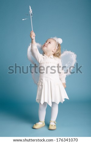 Cute little girl with butterfly costume on blue background - stock photo