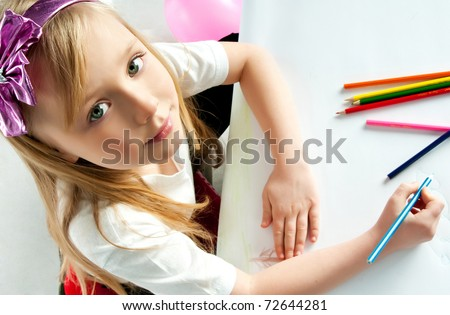 cute little girl with colored pencils - stock photo