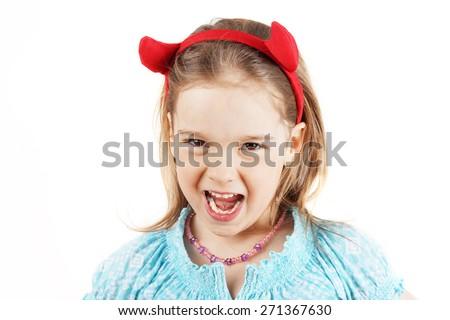 Cute little girl with devil horns head gear - stock photo