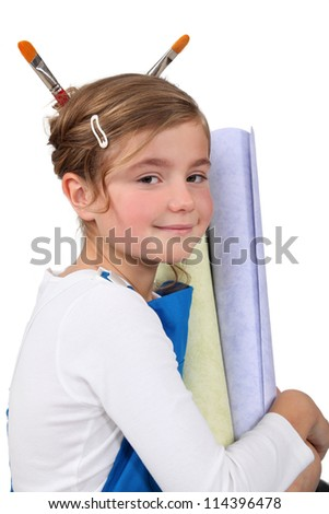 Cute little girl with equipment for home decoration - stock photo