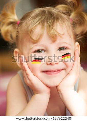 Cute little girl with European flags on cheeks - stock photo