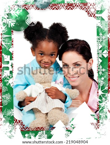 Cute little girl with her doctor smiling at the camera against christmas themed frame - stock photo
