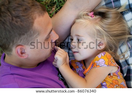 Cute little girl with her father– Outdoor - stock photo